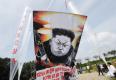 谭博谴责朝鲜再射导弹 外长表示随时支援日本